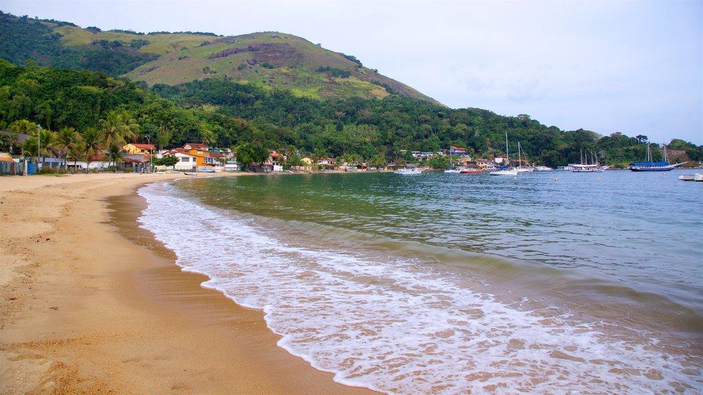 Biscaia Beach which includes a sandy beach, a coastal town and general coastal views