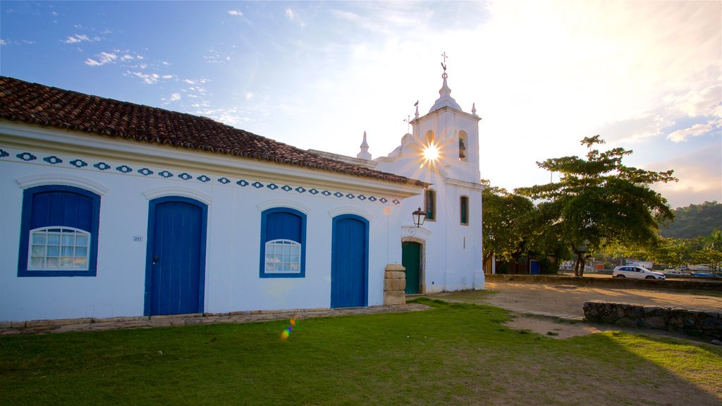 Nossa Senhora das Dores Church which includes a sunset and a church or cathedral