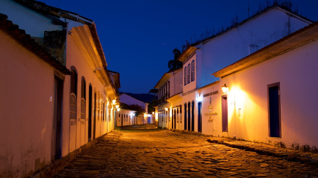 Paraty featuring a small town or village and night scenes
