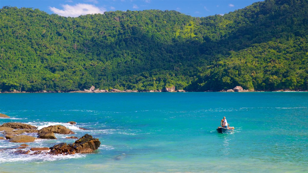 Meio Beach which includes general coastal views, boating and tropical scenes