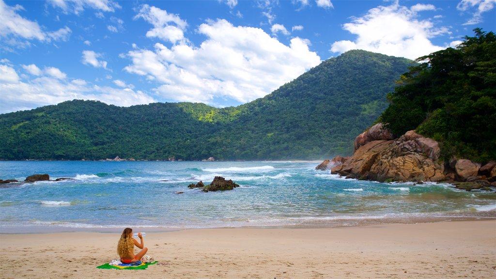 Meio Beach which includes a beach and general coastal views as well as an individual femail