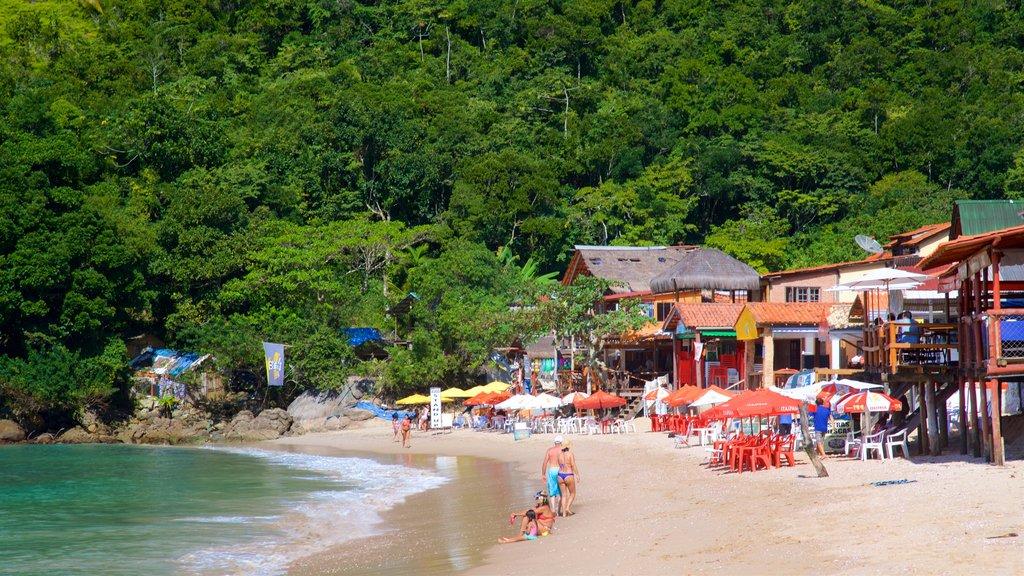 Ranch Beach showing a sandy beach, general coastal views and a coastal town