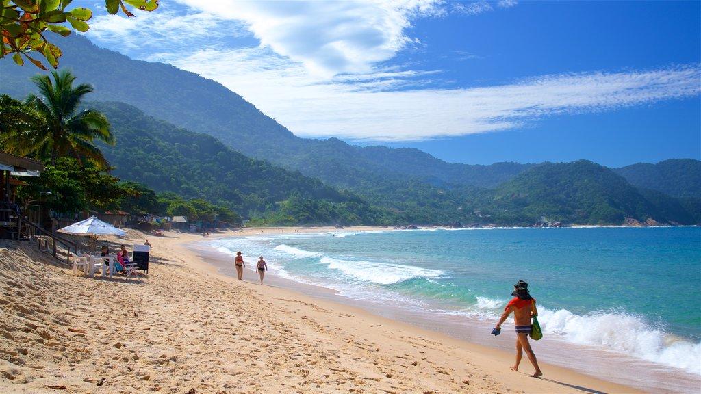 Ranch Beach which includes general coastal views, a sandy beach and tropical scenes