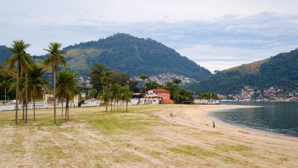 Anil Beach which includes a lake or waterhole, a beach and a coastal town