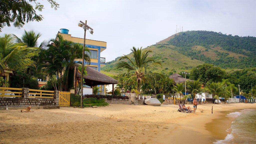 Biscaia Beach featuring a coastal town, a sandy beach and general coastal views