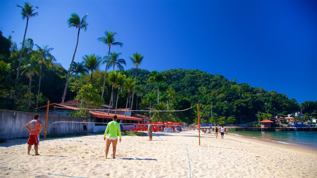 Angra dos Reis showing general coastal views and a sandy beach as well as a small group of people
