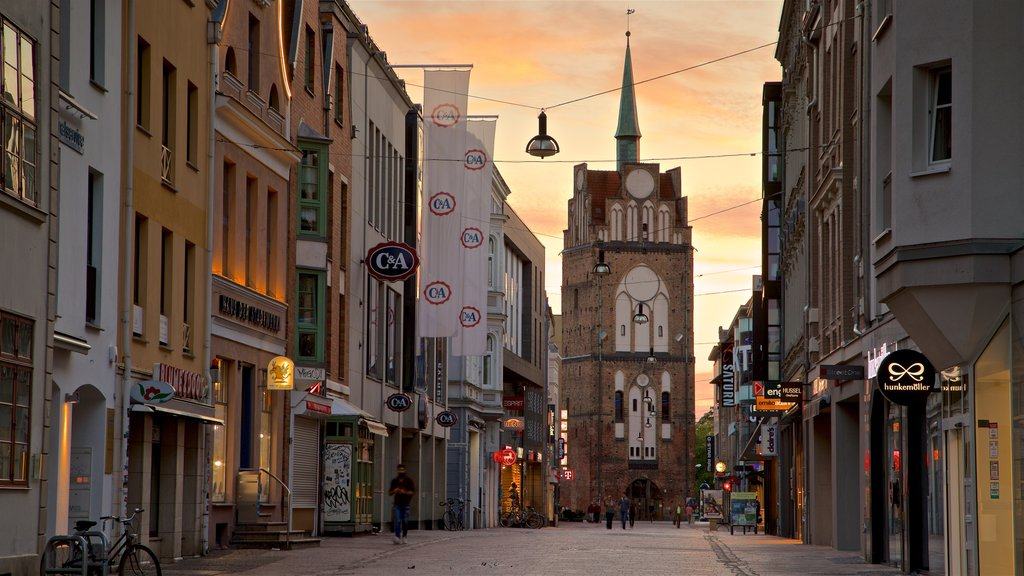 Kröpeliner Tor featuring a sunset, heritage architecture and a city