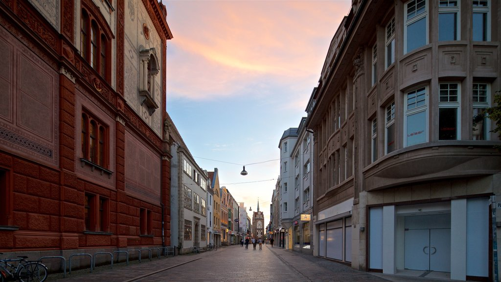 Rostock showing a city and a sunset