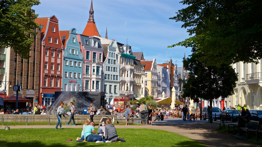 Rostock which includes a garden and a city as well as a small group of people