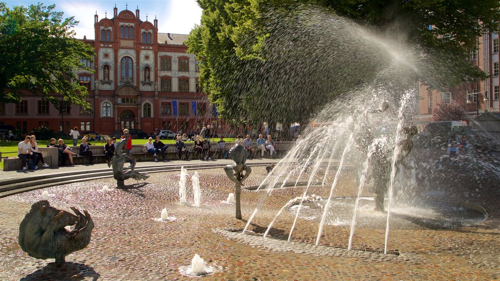 University of Rostock showing a fountain as well as a small group of people