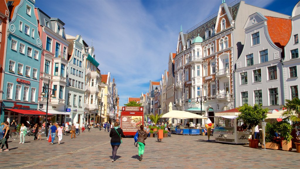 Rostock featuring a city and street scenes as well as a couple