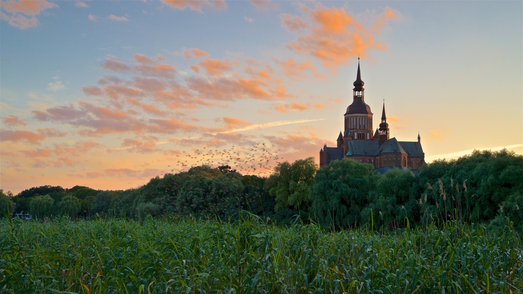 Stralsund featuring heritage architecture and a sunset