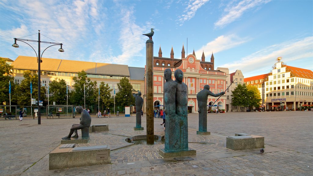 New Market showing a statue or sculpture, a square or plaza and outdoor art