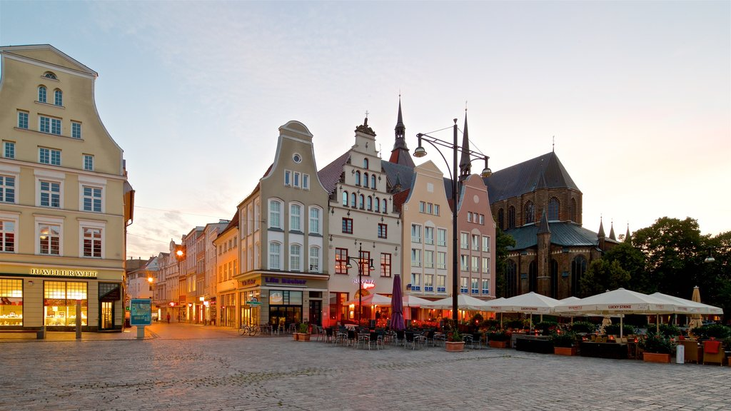 New Market which includes a sunset, a city and a square or plaza
