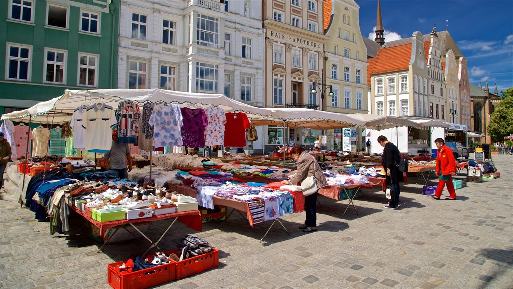New Market which includes markets and street scenes as well as a small group of people
