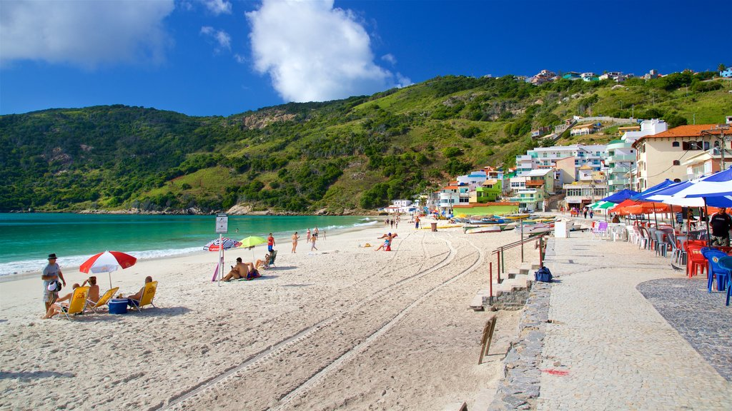 Prainha Beach which includes general coastal views, a coastal town and a beach
