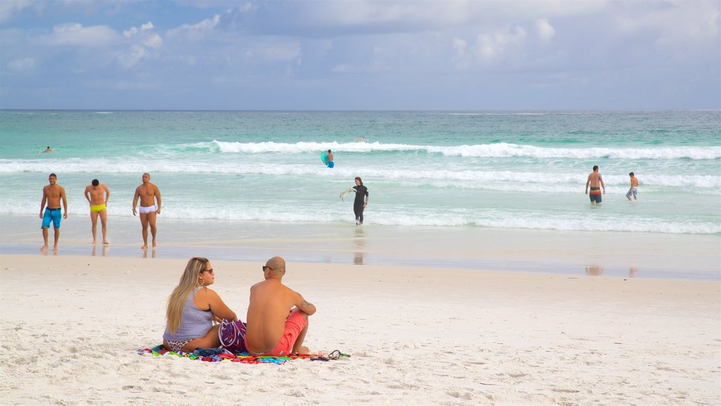 Arraial do Cabo showing a beach and general coastal views as well as a couple