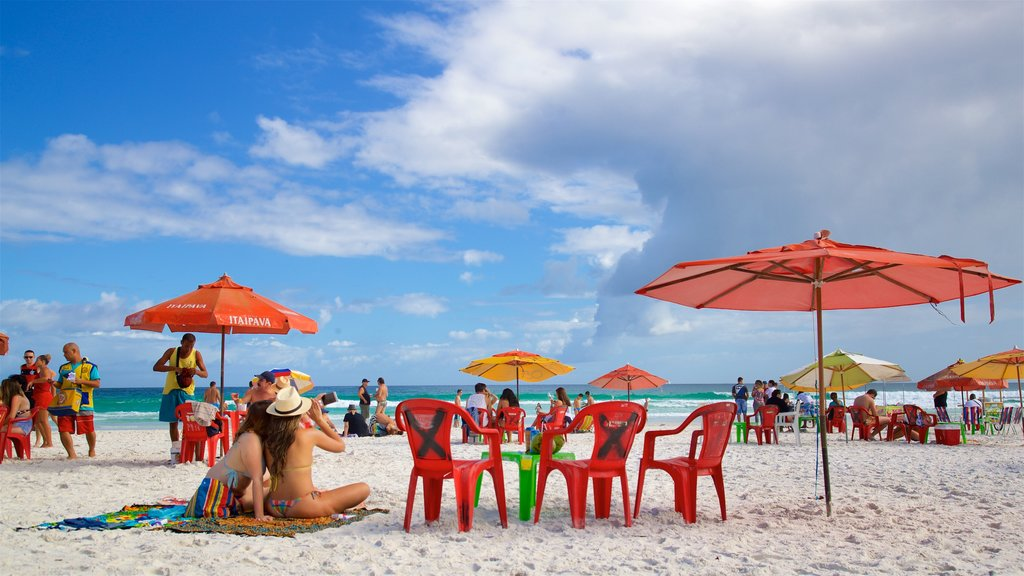 Arraial do Cabo featuring a sandy beach and general coastal views as well as a small group of people