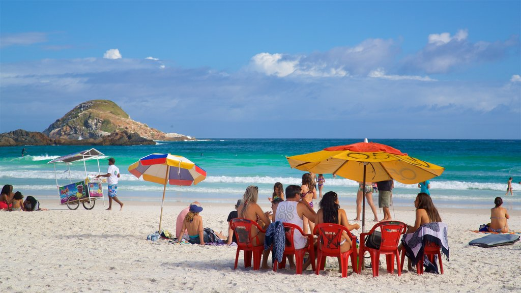 Arraial do Cabo which includes general coastal views and a sandy beach as well as a small group of people