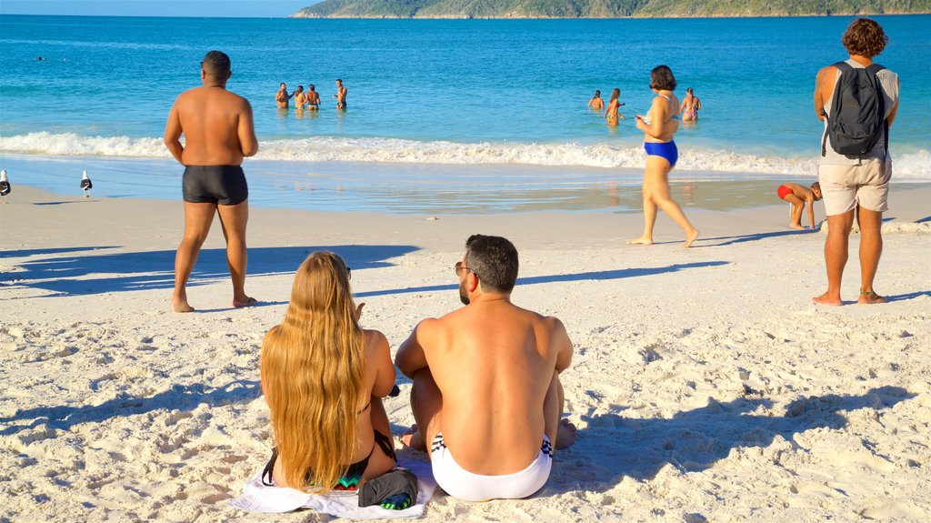 Pontal do Atalaia Beach featuring general coastal views and a sandy beach as well as a couple