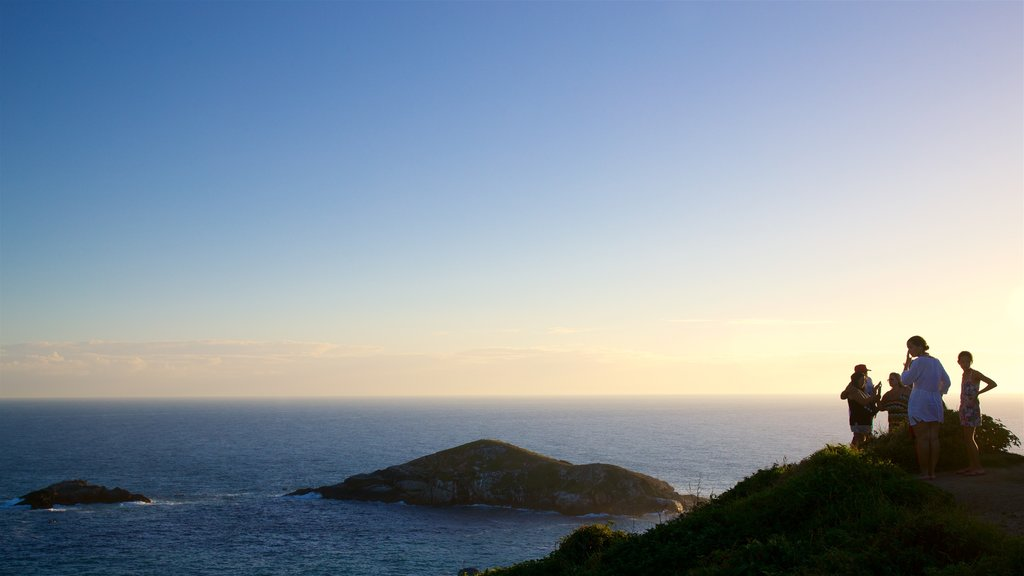 Atalaia Viewpoint which includes island images, a sunset and landscape views