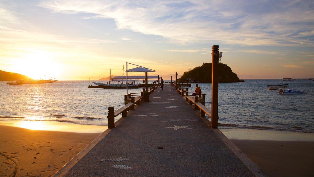Orla Bardot featuring a sunset, a sandy beach and general coastal views