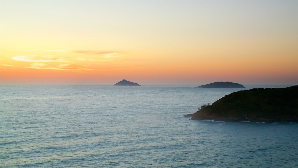 Joao Fernandes Viewpoint showing a sunset, island views and landscape views