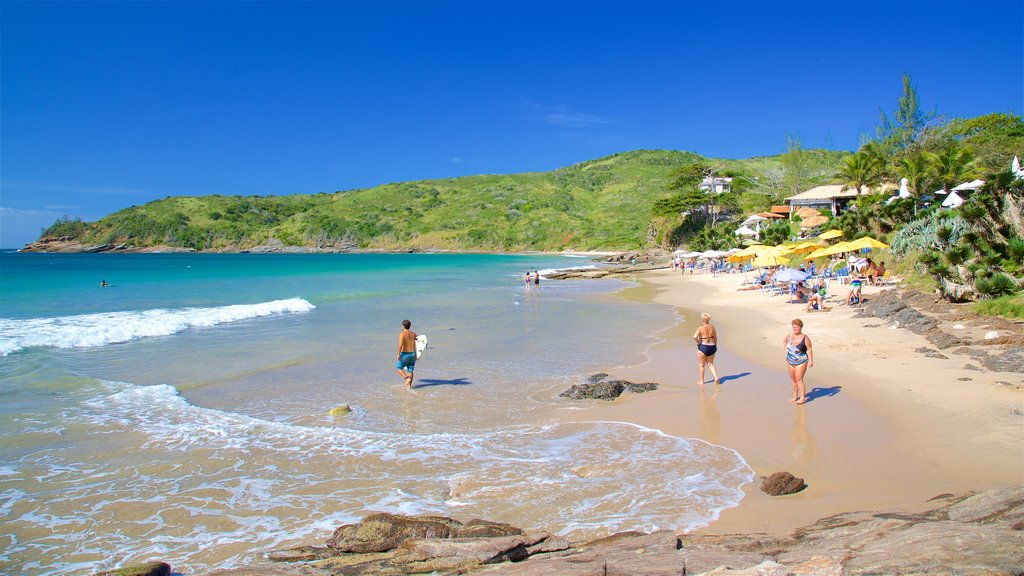 Brava Beach featuring a sandy beach and general coastal views as well as a small group of people