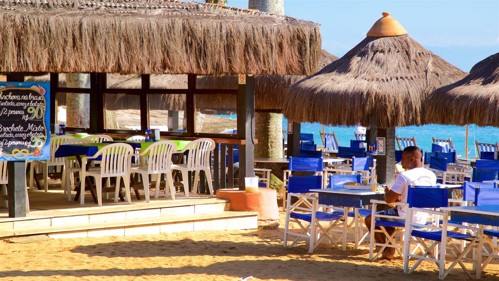 Joao Fernandes Beach which includes tropical scenes, a beach and general coastal views