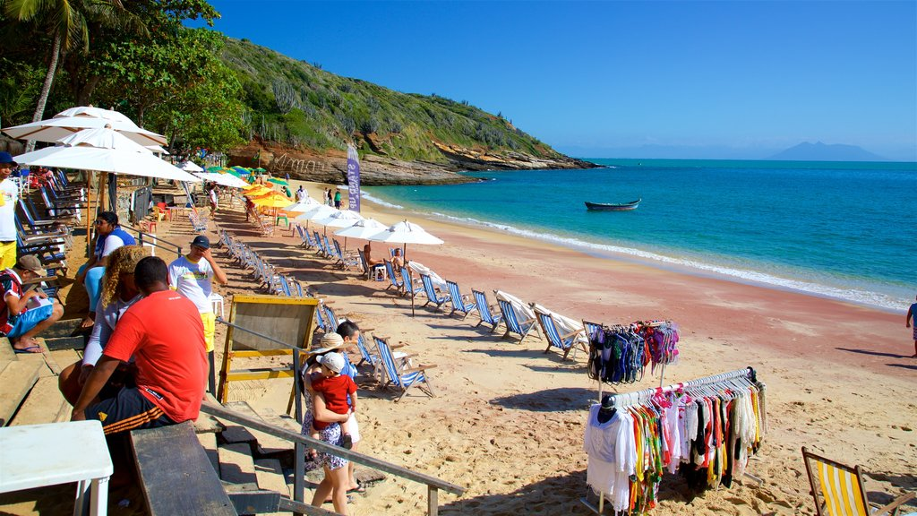 Joao Fernandes Beach which includes a beach and general coastal views as well as a small group of people
