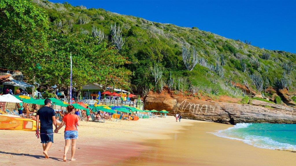 Joao Fernandes Beach featuring a sandy beach and general coastal views as well as a couple