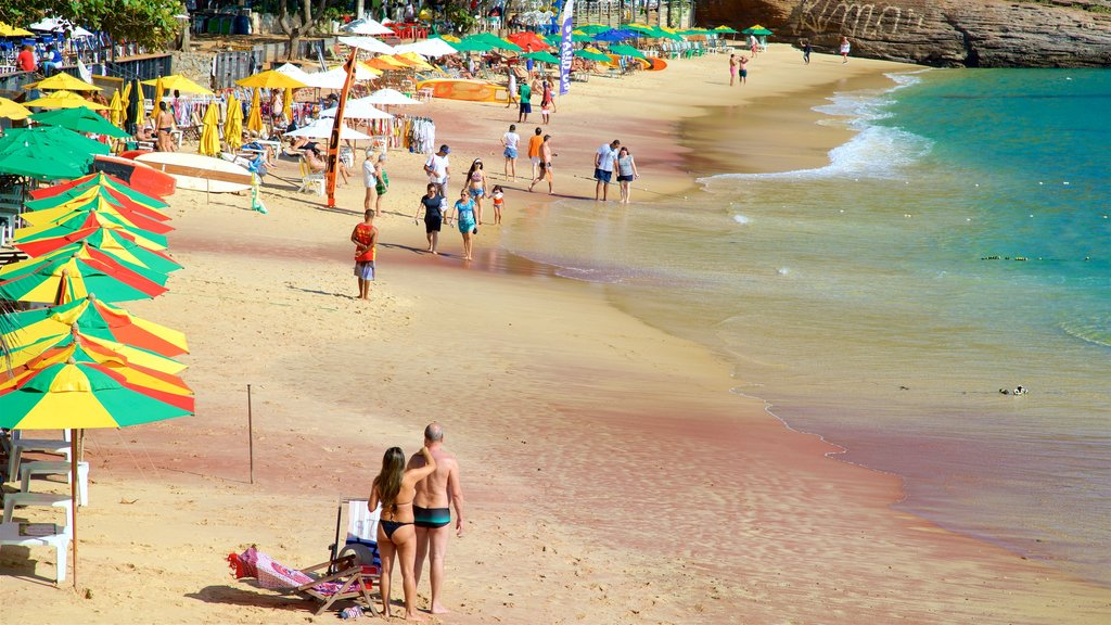 Joao Fernandes Beach which includes a sandy beach and general coastal views as well as a couple