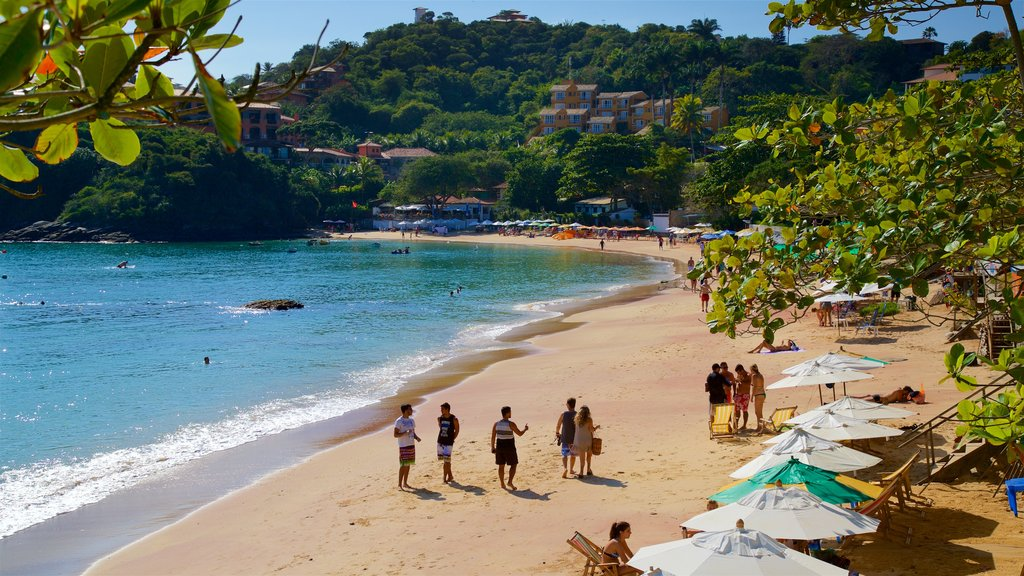 Joao Fernandes Beach showing a sandy beach and general coastal views as well as a small group of people