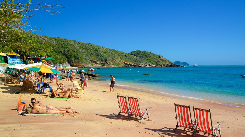 Joao Fernandes Beach featuring a beach and general coastal views as well as a small group of people