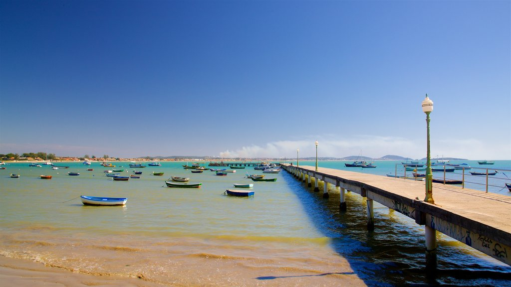 Manguinhos Beach showing a bay or harbor, a sandy beach and general coastal views
