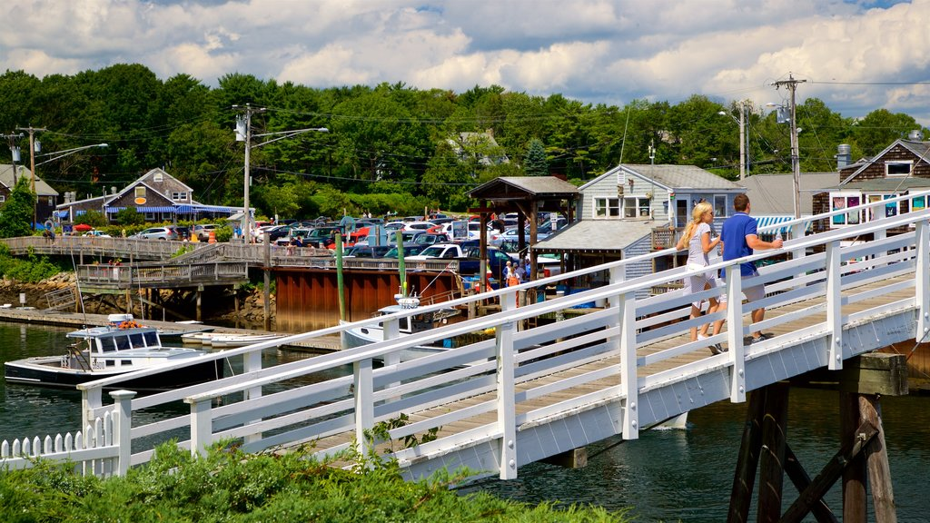 Ogunquit showing a river or creek and a bridge as well as a couple