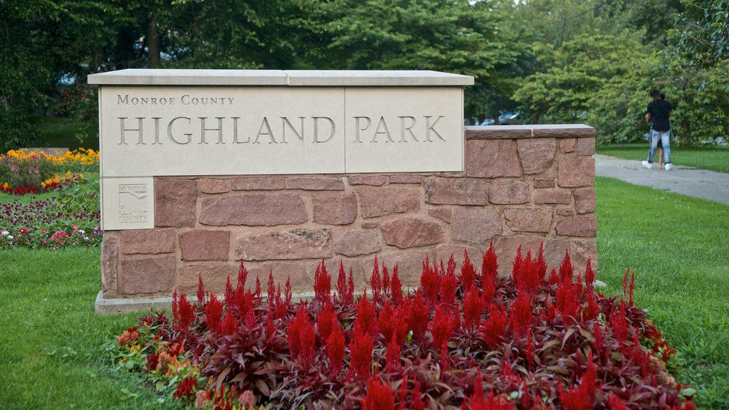Highland Park featuring signage, a park and wildflowers