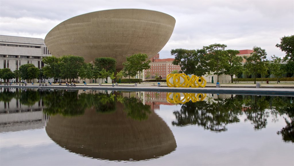 The Egg showing modern architecture, a pond and outdoor art