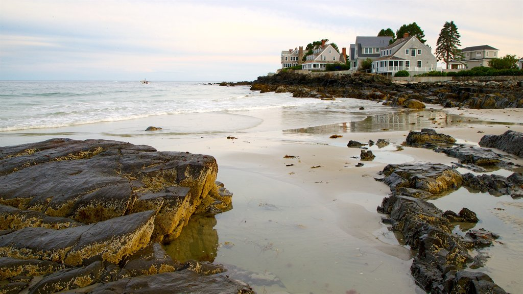 Mother\'s Beach which includes rugged coastline, a sandy beach and a house