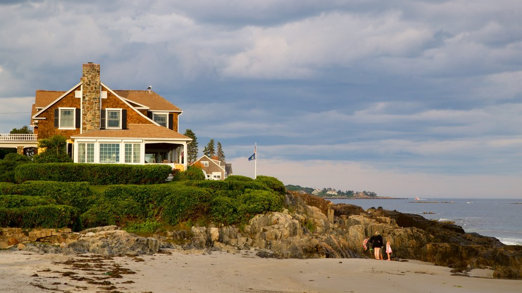 Mother\'s Beach featuring a beach, a house and rugged coastline