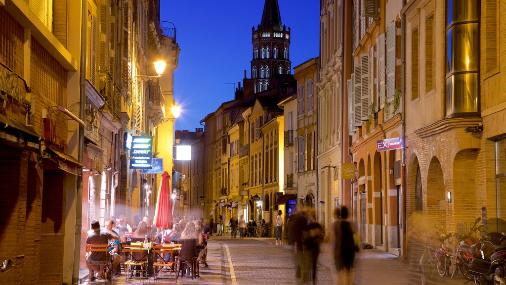 Toulouse featuring night scenes, street scenes and a city