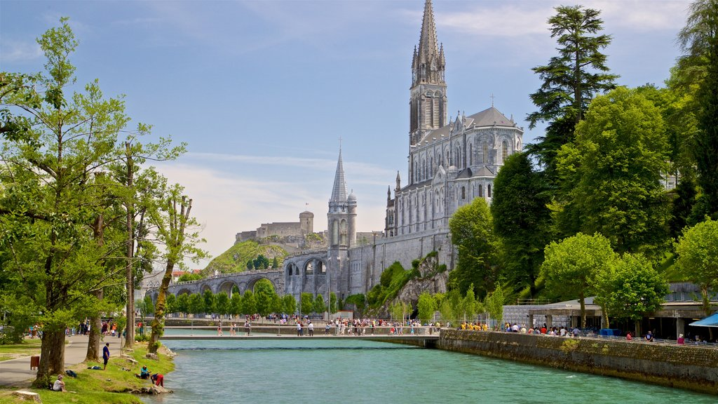 Notre-Dame de l\'Immaculee-Conception which includes heritage architecture, a river or creek and a church or cathedral