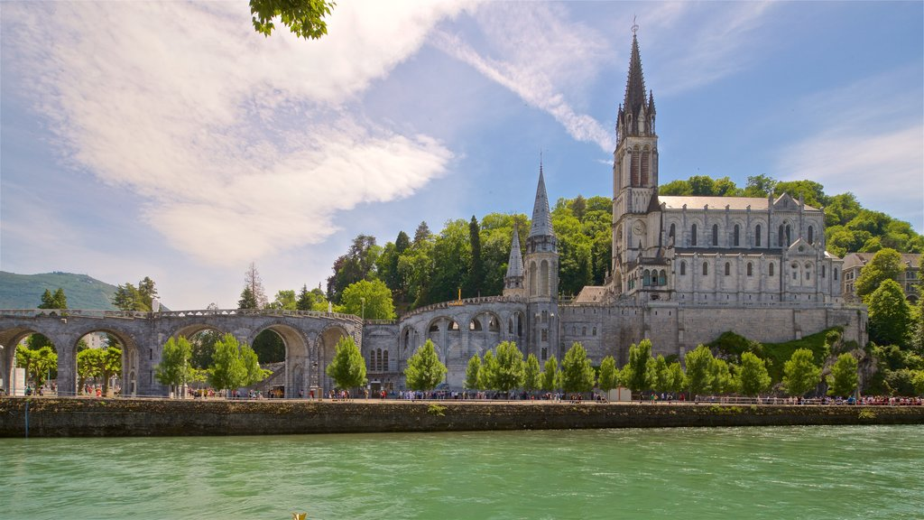 Notre-Dame de l\'Immaculee-Conception showing heritage architecture, a river or creek and a church or cathedral