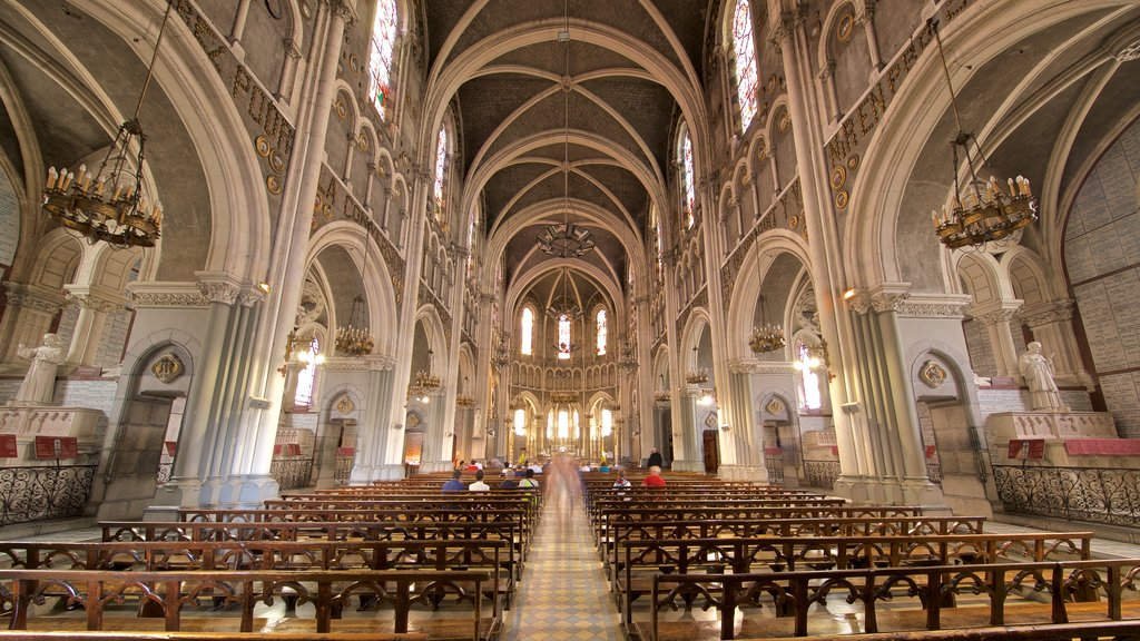 Notre-Dame de l\'Immaculee-Conception showing heritage elements, a church or cathedral and interior views