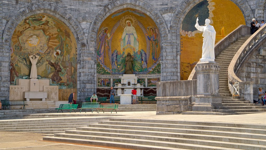 Rosary Basilica featuring a statue or sculpture, religious aspects and art