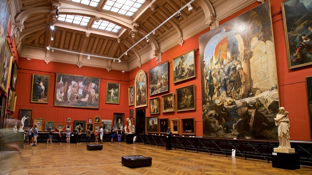 Museum of the Augustins showing interior views and art as well as a small group of people