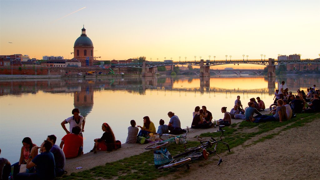 Garonne which includes a sunset, heritage architecture and a bridge