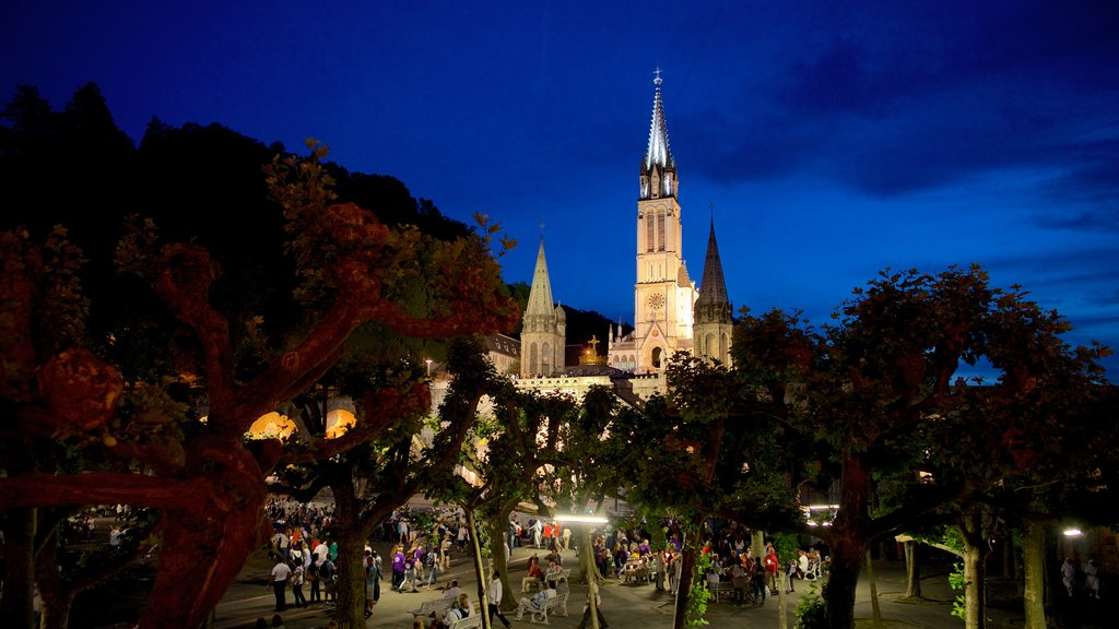 Lourdes featuring night scenes, heritage architecture and a church or cathedral