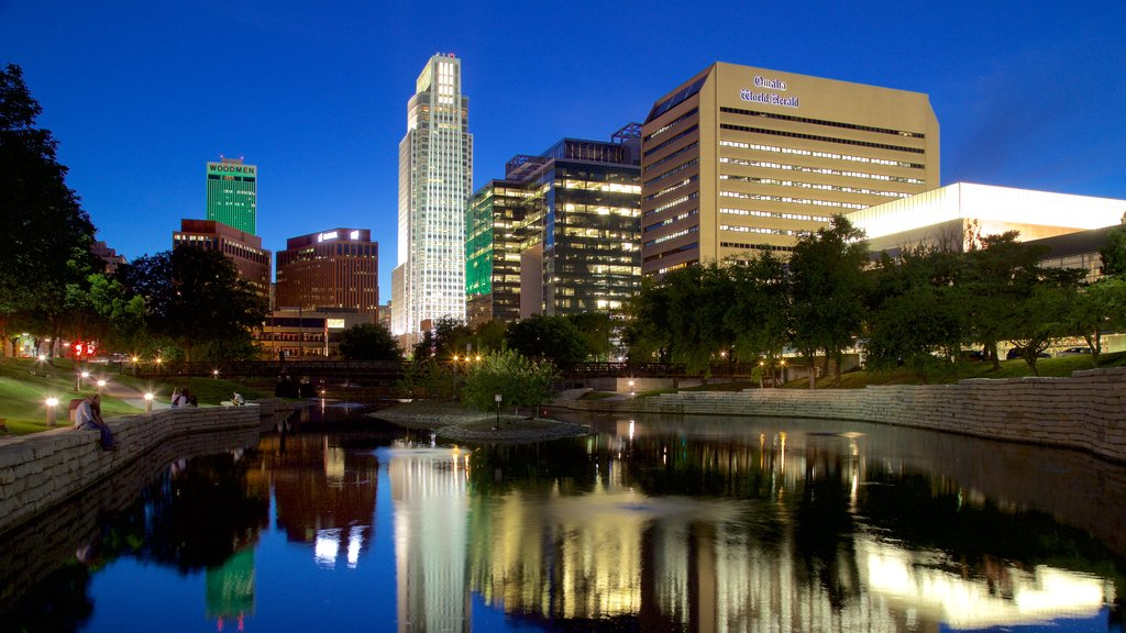 Omaha showing a high rise building, night scenes and a city