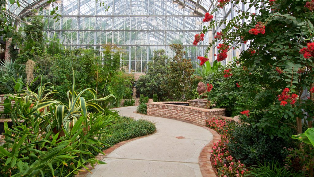 Lauritzen Gardens featuring a park, flowers and interior views